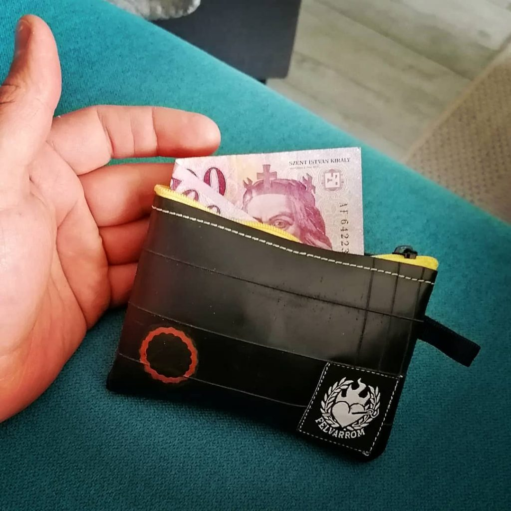 Inner tube coin purse from recycled biketube black, with money inside